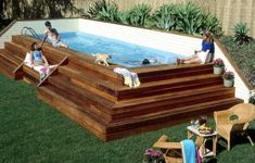 Cool Rectangular Above Ground Pool Deck Surrounded With Grass Garden : Inspirational Spacious Backyard Garden with Cool Above Ground Pool Deck Designs