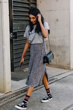 grey t-shirt (tied), dark grey midi dress, long socks, nike sneakers, black handbag, hair out