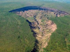The Batagaika crater, dubbed the 'gateway to the underworld', runs through the east Siberian taiga. Picture: Alexander Gabyshev