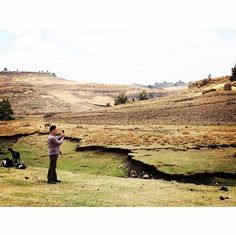 April 4, 2015: Eduardo Rodriguez grabs a few shots of the countryside after following Mark & Jodi Visser as they carried dirty water to a family's home.