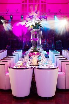 Contemporary designed event with radiant orchid lighting @}-,-;--