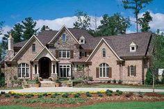 Master on main, rear garage House Plan 54-111