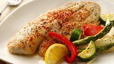 Four kinds of vegetables are baked alongside tilapia for a mouth-watering meal in one!
