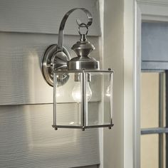 Sporting traditional design elements and a gleaming nickel finish, the Pellston Outdoor Wall Lantern will light up your home in more ways than one. Outdoor Wall Lantern, Outdoor Wall Sconce, Hanging Lanterns, Outdoor Wall Lighting, Exterior Lighting, Outdoor Walls, Lighting Ideas, Lantern Chandelier, Kitchen Lighting