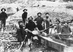 A crew displaying a large nugget from their sluices.  Klondike Gold Rush