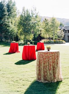 Love the red high top cocktail tables with an ivory overlay for a chic and romantic atmosphere.