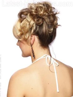 This pretty style would be great for a wedding or prom hairstyle. Sweet curls are pinned up and off the shoulders onto the top of the head and a thick fringe area helps add softness and frames the face.