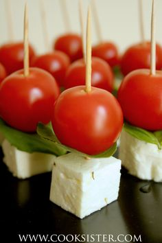 Cherry tomato, marinated feta & basil mini-skewers