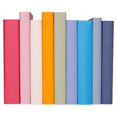 Easily add color to a room with these hardcover books hand-wrapped in fine art paper.