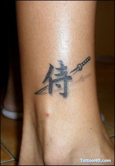 Japanese Kanji Symbol With Sword Tattoo On Ankle