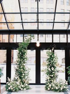 An asymmetrical floral arch designed for this downtown Detroit wedding full of flowers in white and green shades, and accents of dusty blue throughout. White Wedding Arch, Green Wedding, Floral Wedding, Green And White Wedding Flowers, Wedding Ceremony Flowers, Wedding Ceremony Decorations, Ceremony Backdrop, Floral Arch, Detroit Wedding