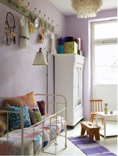 I love this look for a little girls room, especially the hooks up high, keeps clutter down below at a minimum but is still inviting.
