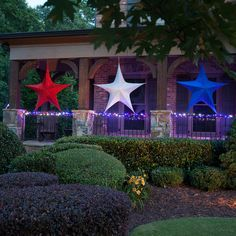 Patriotic Porch Decorations -unlit red white and blue stars look so pretty hanging across the porch during the day and a railing wrapped with red white and blue string lights creates a gorgeous glow at night! Commercial Christmas Lights, Commercial Christmas Decorations, Christmas Star Decorations, Patriotic Decorations, Light Decorations, Christmas Trees, Coastal Christmas, Holiday Decor, Blue Christmas Lights