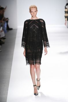 CUSTO BARCELONA Catalan designer. Black lace dress Custo Barcelona at New York Fashion Week Spring 2014