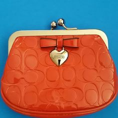 Authentic Coach change wallet Super cute and even cuter in person! Carried 1 time, no marks and new!!! Has a little bow in front to add more cuteness. Please no low ball offers. Bags Wallets