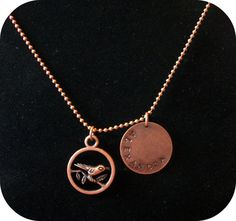 Antique Copper hand stamped name pendant with bird in a circle charm.  Reminds me of the mockingjay from Hunger Games! :D 14$