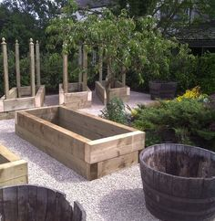 Raised Beds with wine barrels in between for herbs, and trees. Maybe the granadilla on an arch! LOVE all these ideas.Sleeper Raised Beds with wine barrels in between for herbs, and trees. Maybe the granadilla on an arch! LOVE all these ideas. Raised Beds Sleepers, Sleepers In Garden, Raised Garden Beds, Vegetable Garden Design, Veg Garden, Garden Boxes, Garden Planters, Vegetable Gardening, Garden Ideas