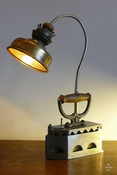 Old Iron Table Lamp Designed by ML Upcycling Licht. See more ideas in 22 Old Things That Make Awesome DIY Lamps. lamp 22 Old Things That Make Awesome DIY Lamps Lampe Steampunk, Recycled Lamp, Repurposed, Best Desk Lamp, Farmhouse Lamps, Brass Lamp, Pendant Lamps, Antique Lamps, Old Lamps
