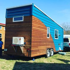 One of the many tiny houses for the weekend. I have yet to enter this one it has had a line all day long. #tinyhouse #tinyliving #tinyhousefestival #unitedtinyhouse #gatinyhousefestival