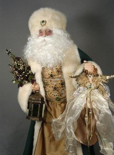 Each Santa Claus doll is adorned with very special gifts, wreaths, and trees, and have exquisite sculpted faces. Description from santasbycsf.com. I searched for this on bing.com/images