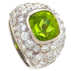 René Boivin Art Deco Peridot Diamond Gold Ring | From a unique collection of vintage dome rings at https://www.1stdibs.com/jewelry/rings/dome-rings/