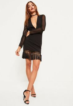 Shake it 'til you make it! For a high voltage attitude, own the weekend in this LBD with its tassel hem, v plunge neck and bodycon fit.