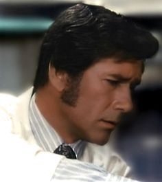 Dr. Brackett doing something important and medical here but: sideburns.