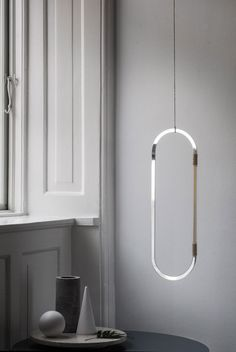 I would love to watch the subtle play of light that the series of hanging mirror mobiles by Danish design studio Elkeland provides. Each mobile is made of double sided acrylic-mirror and brass sticks, assembled in hand with beewax treated flax string. Industrial Lighting, Modern Lighting, Lighting Design, Pendant Lighting, Pendant Lamp, Chandelier, Lighting Ideas, Industrial Style, Industrial Design