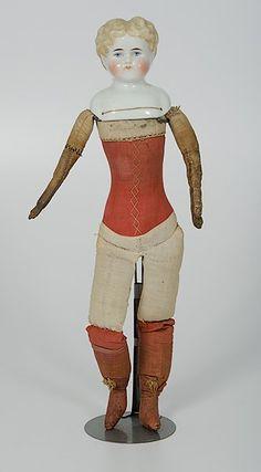 German China Head Doll with Muslin body, 1800s.