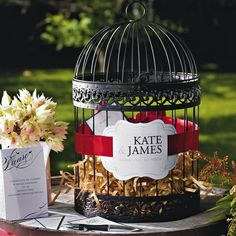 Ask guests to write their wishes on printed stationery, and then drop the cards in an antique birdcage!
