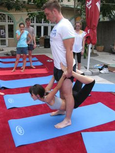 What to do when those public yoga mats are too disgusting to even touch with your bare belly..... try the acro yoga portable bow pose.. Acro yoga, 'cause Yoga  is more fun with good company when your friends are the yoga mat and props!