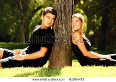 stock photo : Young couple resting in the park near the tree