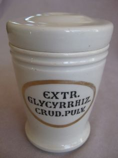 "A  white pottery glazed Pharmacy drug pot with an oval shaped gilt cartouche containing the words... Extr. Glycyrrhiz. Crud. Pilv.  English   Circa 1900  Height 5 """