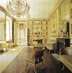 Wooden floorboards combined with the gilted mirrors, floral wallpaper and the ornate chandelier. Klismos chairs and lounge - Gustavian period.