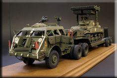 Dragon Wagon hauling a Sherman tank w/ rocket launcher.