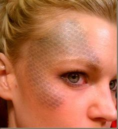 Mermaid scales created with fishnets and eye shadow. #makeup #costumes #Halloween #mermaids