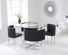 Buy the Algarve Glass Stowaway Dining Table with White High Back Stools at Oak Furniture Superstore