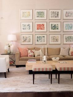 Make a colorful splash with a gallery wall. Artwork can be expensive, but if you're looking for a more budget-friendly option, try websites like 20x200.com, society6.com and Etsy.com. Here, designer Sarah Richardson uses a mix of abstract prints in a variety of hues from the living room's color palette to create this impressive display.
