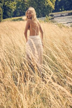 Top model Toni Garrn travels to the outdoors for an ethereal shoot featured in the August 2017 issue of Paris Match. Photographed by Fred Meylan, the face of Calzedonia wears lingerie inspired looks in the editorial. Charlotte Renard styles Toni in chic pieces including bralettes, off-the-shoulder tops as well as ruffled separates.