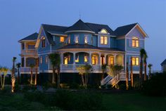 Beautiful, blue Victorian on the Dunes in SC. Love that eyebrow window and the shutters.