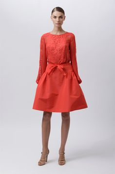 monotone ensemble. simple blouse with lace detail. strong coral colour certainly not for everyone. {monique lhuillier resort 2012 collection via style.com}