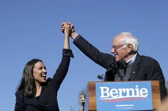 """Bernie Sanders Returns To The Trail With AOC, A Giant Crowd, And A Defiant Campaign , { """"id"""": 123502079 } Kena Betancur / Getty Images Sen. Bernie Sanders with Rep. Alexandria Ocasio-Cortez during his speech at a campaign rally in Queen. Elizabeth Warren, Bernie Sanders, Michael Moore, Donald Trump, Democratic Primary, Democratic Party, Cortez, Joe Biden, Us History"""