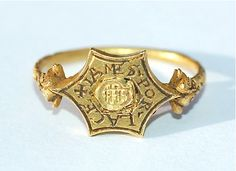 Tudor Death's Head Ring  An exceptionally rare Tudor memento mori ring, circa 1550 -1600. Such rings were a timely reminder of the importance of spiritual preparation for death and one is listed in Henry VIII's inventory : A ring of golde with a deathes hedde. This high carat gold ring has a hexagonal bezel with central skull, around which is inscribed the name of the deceased, Iames [James] Porlace. The ring is decorated with volutes and foliate shoulders.