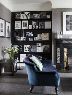 Greys and Black.Home & Interiors - love how the fashion books are displayed.  Gris et bleu:  coloration inspiration pour le ss-sol...