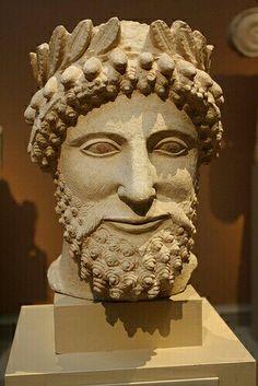 - Cabeza Etrusca . Piedra caliza chipriota . Siglo V a.C./tcc