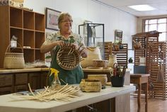 Debra Mills weaves her one-of-a-kind basketry at Studio 19, a studio and gallery she shares with two other local artisans in downtown Bryson City, NC.