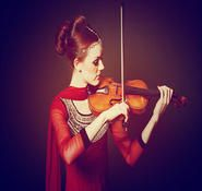Violinist hire. Our professional Violin player can be hired in London and the UK.