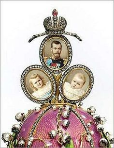 When a gold-mounted pearl button at the side is turned the surprise slowly rises from the base, and spreads into three portraits of Tsar Nicholas II in military uniform and his first two daughters, the Grand Duchesses Olga and Tatiana. A turn in the opposite direction automatically folds and returns the miniatures back into the interior of the Egg. The date, April 5, 1898 is engraved on the reverse of the miniatures. The miniatures are painted on ivory by Johannes Zehngraf.