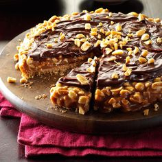 Caramel Peanut Fantasy Recipe - Packed with peanuts and gooey caramel, this do-ahead treat is one sweet dream of a dessert. With an easy cookie crust and scrumptious candy bar layers, it goes together quickly—and will disappear just as fast! 13 Desserts, Delicious Desserts, Potluck Desserts, Layered Desserts, Fudge, Snickers Candy Bar, Snickers Dessert, Cookie Recipes, Dessert Recipes