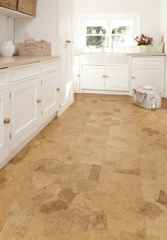 All-white kitchen with OSB flooring  Bloom : Wall & floor coverings by Granorte